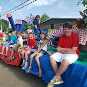 Children who are residents of White Pine, TN, sitting on a parade float